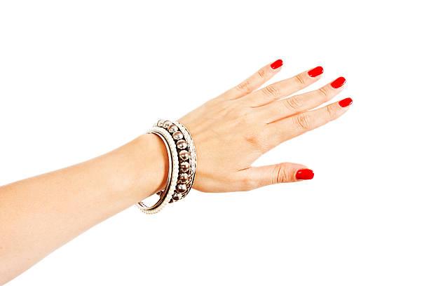 young woman wearing many silver bangles - hand gold jewels bildbanksfoton och bilder