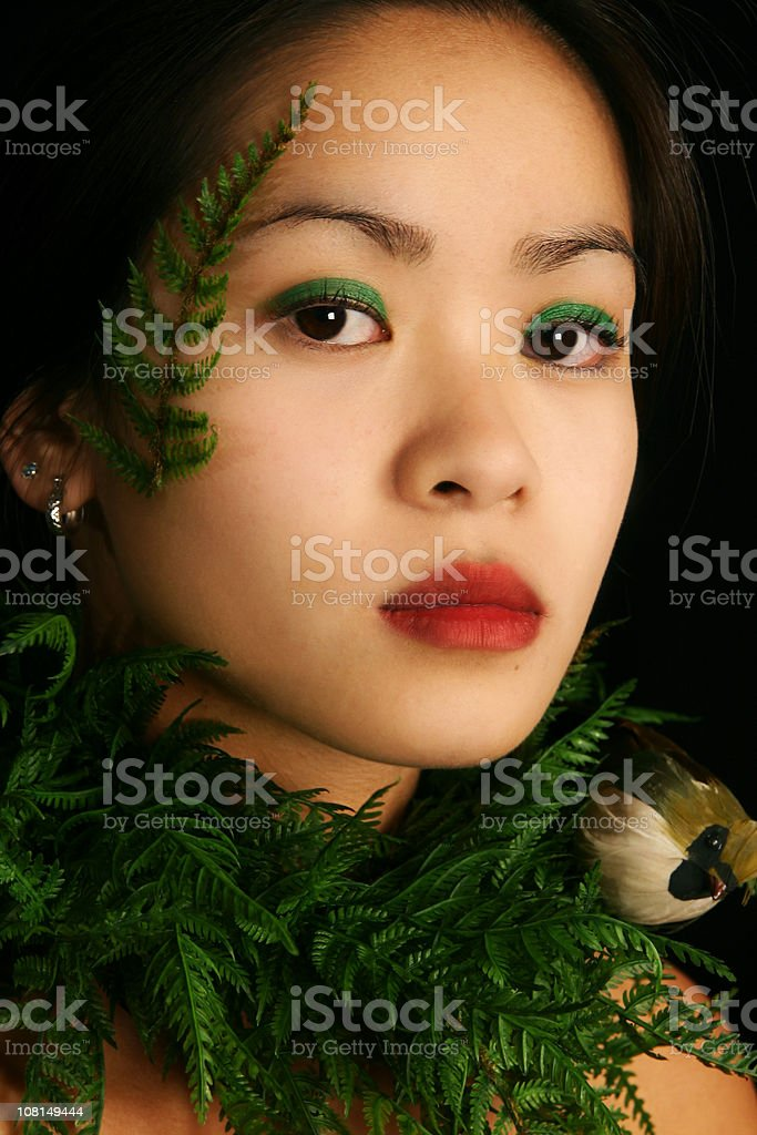Young Woman Wearing Plants stock photo
