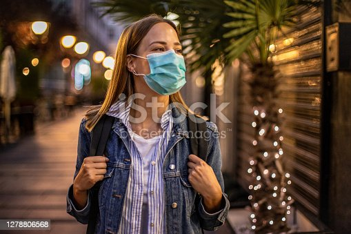 istock Young woman wearing protective mask during holidays 1278806568