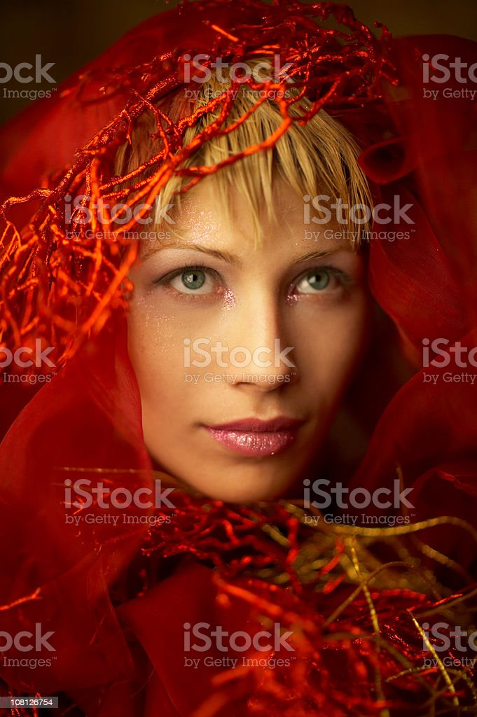Young Woman Wearing Red Scarf Shawl on Head royalty-free stock photo
