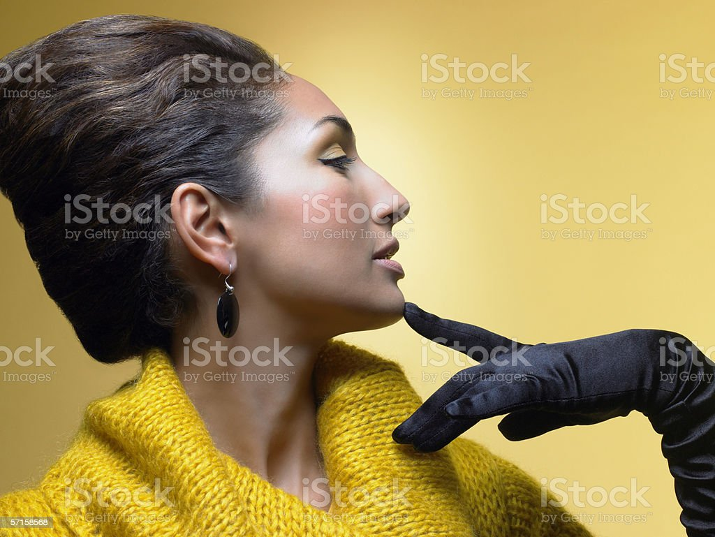Young woman wearing satin gloves stock photo