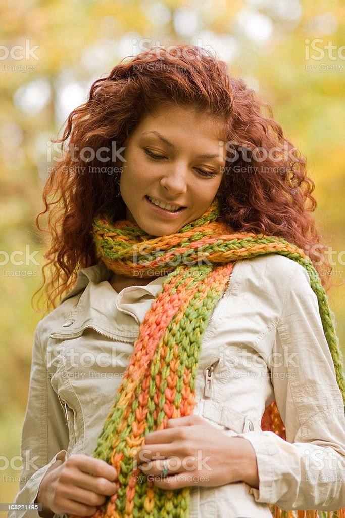 Young Woman Wearing Scarf and Posing Outside During Autumn royalty-free stock photo