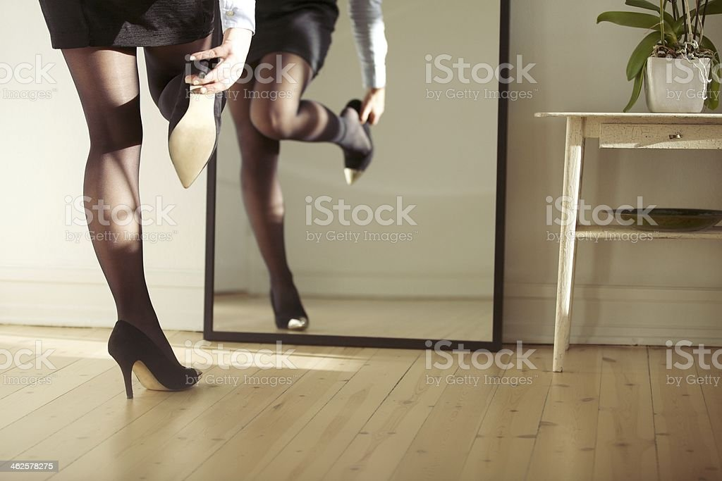 Young woman wearing shoes stock photo