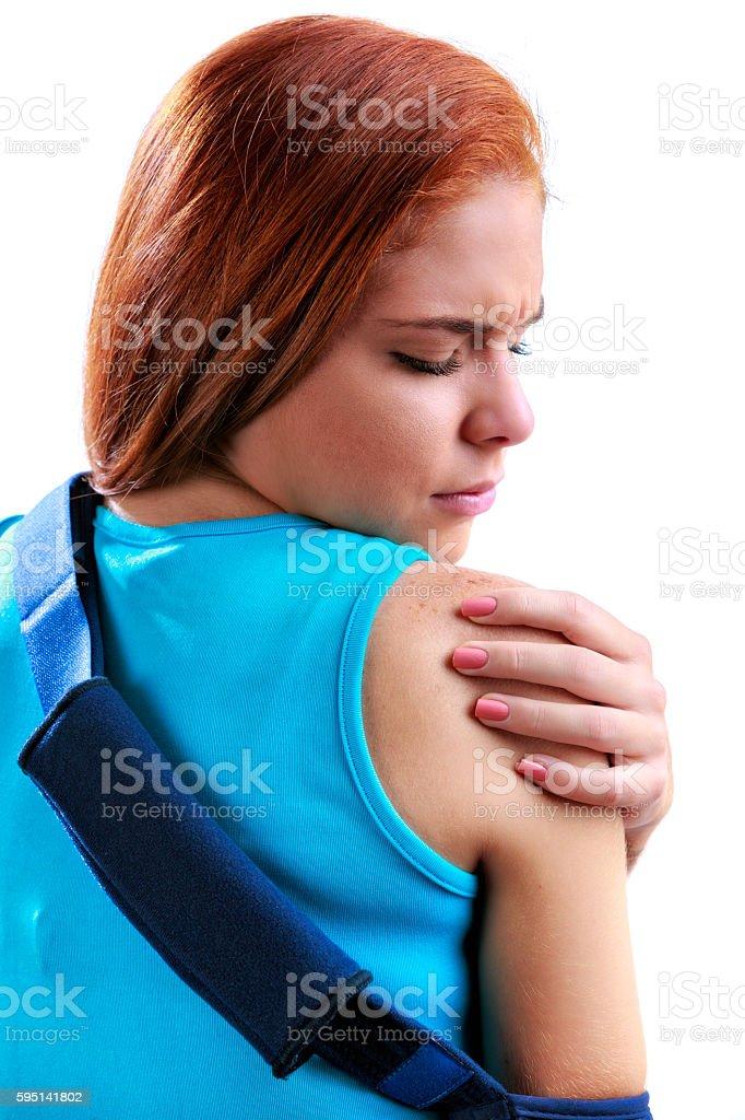 Young woman wearing shoulder brace due to rotator cuff pain stock photo
