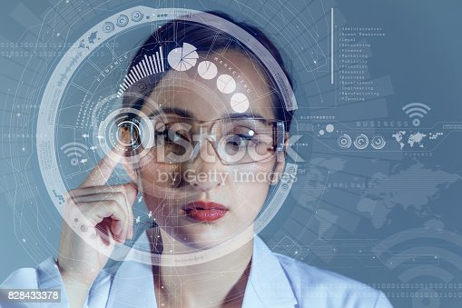 istock young woman wearing smart glasses. wearable computing concept. 828433378