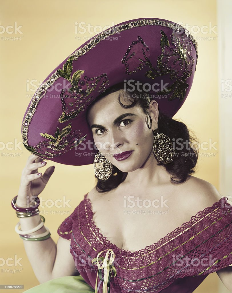 Young woman wearing sombrero, smiling, portrait stock photo