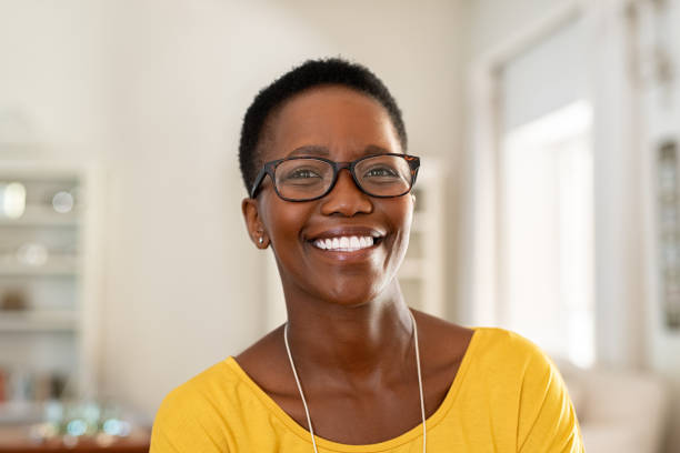 Young woman wearing spectacles Portrait of young woman at home wearing spectacles. Beautiful mature woman wearing eyeglasses and looking at camera. Cheerful african american lady with glasses and short hair. black woman stock pictures, royalty-free photos & images