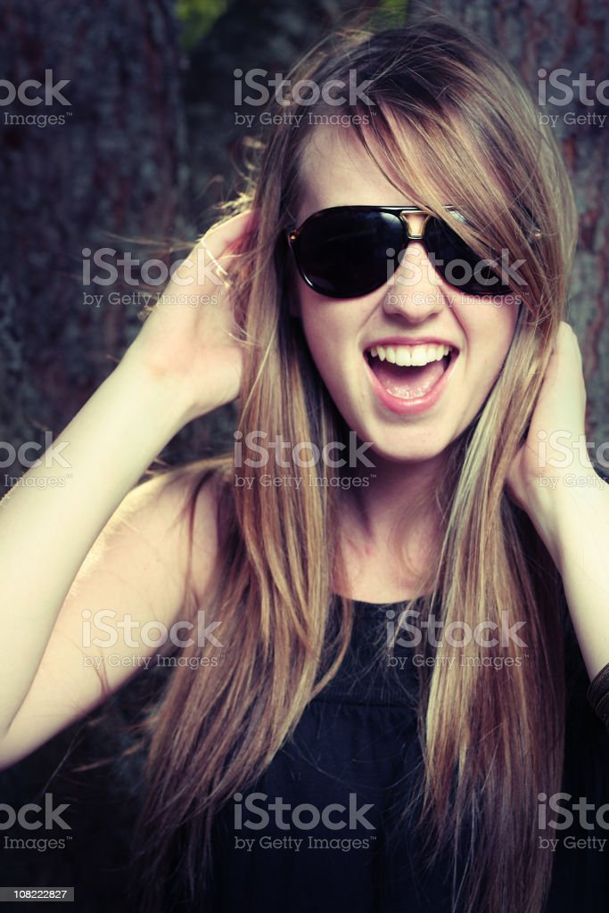 Young Woman Wearing Sunglasses and Having Fun royalty-free stock photo