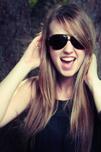 Young Woman Wearing Sunglasses and Having Fun stock photo