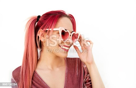 istock Young woman wearing sunglasses 998706284