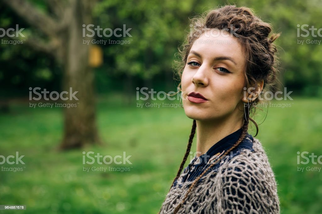 Young woman wearing sweater  and posing the park royalty-free stock photo