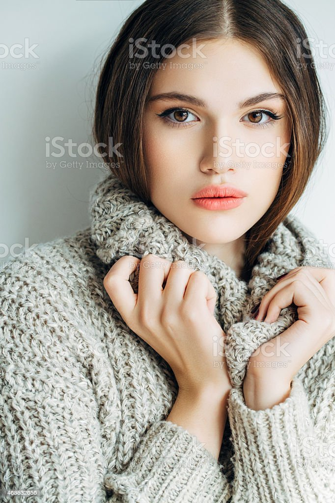 Young woman wearing sweater stock photo