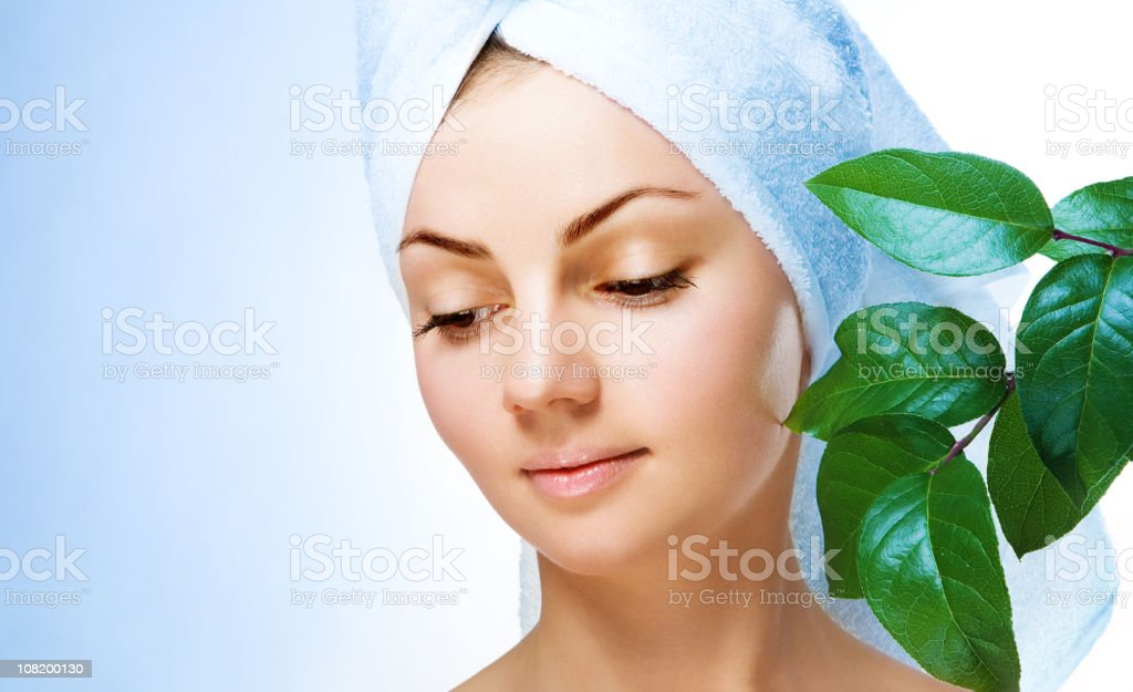 Young Woman Wearing Towel Around Head royalty-free stock photo