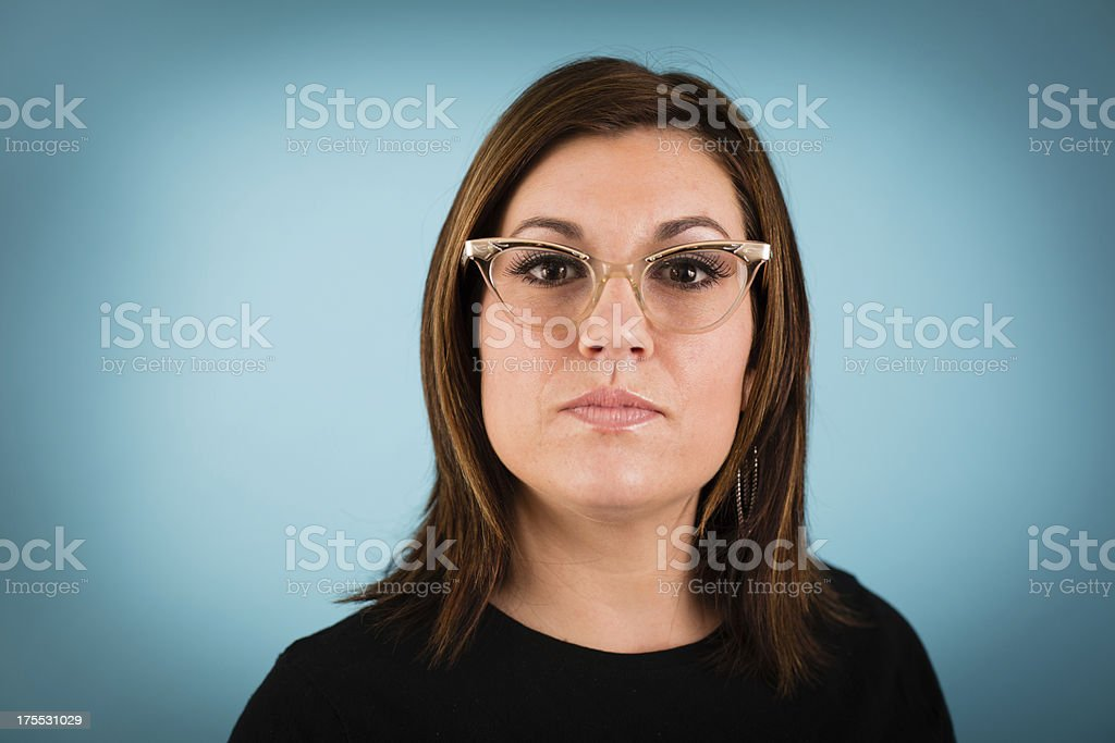 Young Woman Wearing Vintage Cat's Eye Glasses royalty-free stock photo