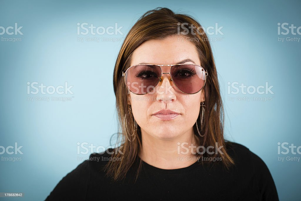 Young Woman Wearing Vintage Sunglasses stock photo