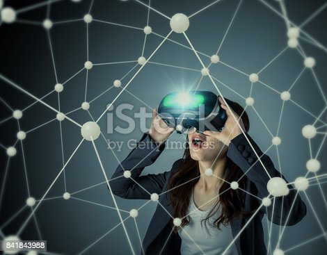 872677426 istock photo young woman wearing virtual reality goggles and floating 3D network image. 3D rendering graphics. abstract mixed media. 841843988