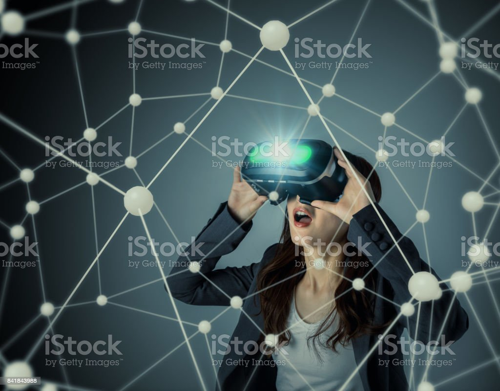 young woman wearing virtual reality goggles and floating 3D network image. 3D rendering graphics. abstract mixed media. stock photo