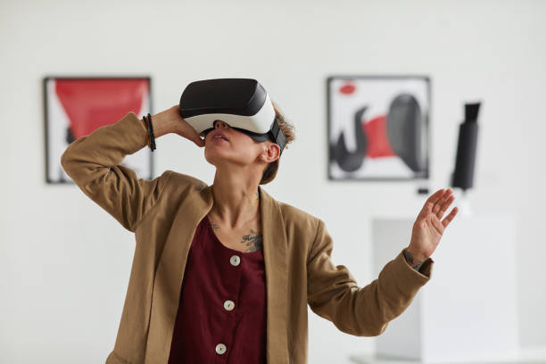 Young Woman Wearing VR in Museum of Modern Art stock photo