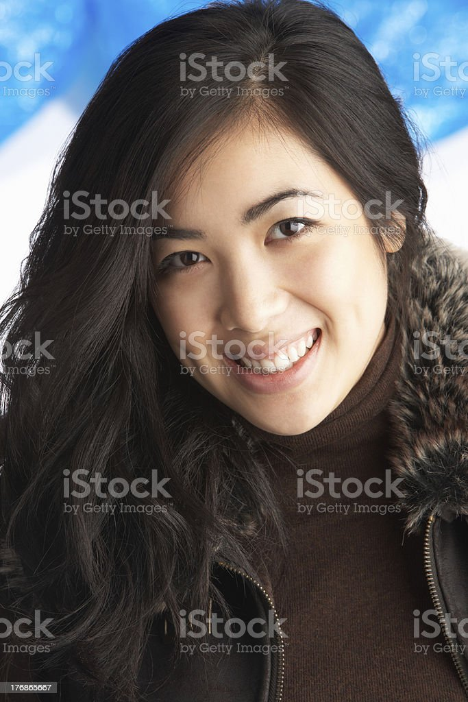 Young Woman Wearing Warm Winter Clothes In Studio stock photo