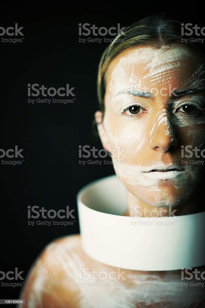 Young Woman Wearing White Body Paint and Plastic Neck Tube royalty-free stock photo