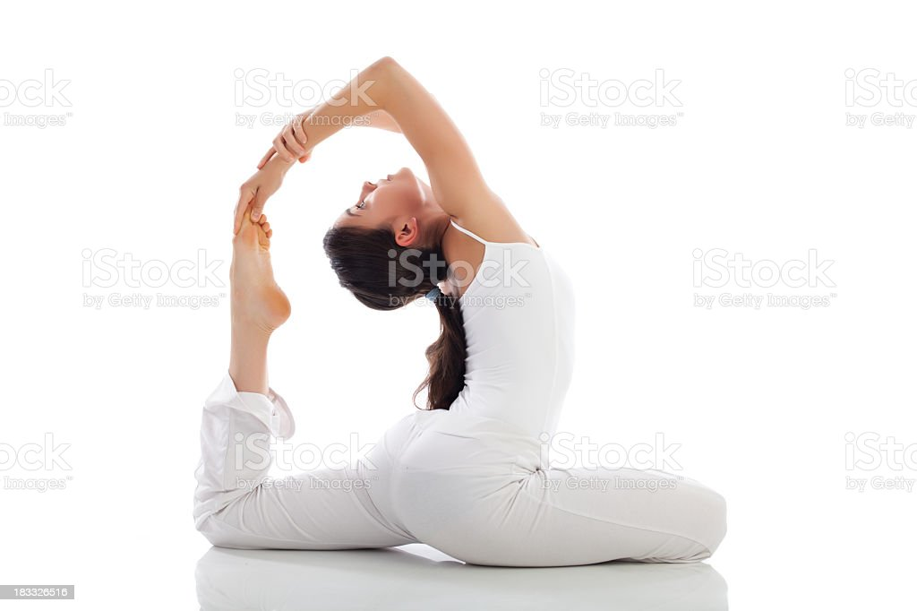 Young woman wearing white performing yoga exercise royalty-free stock photo
