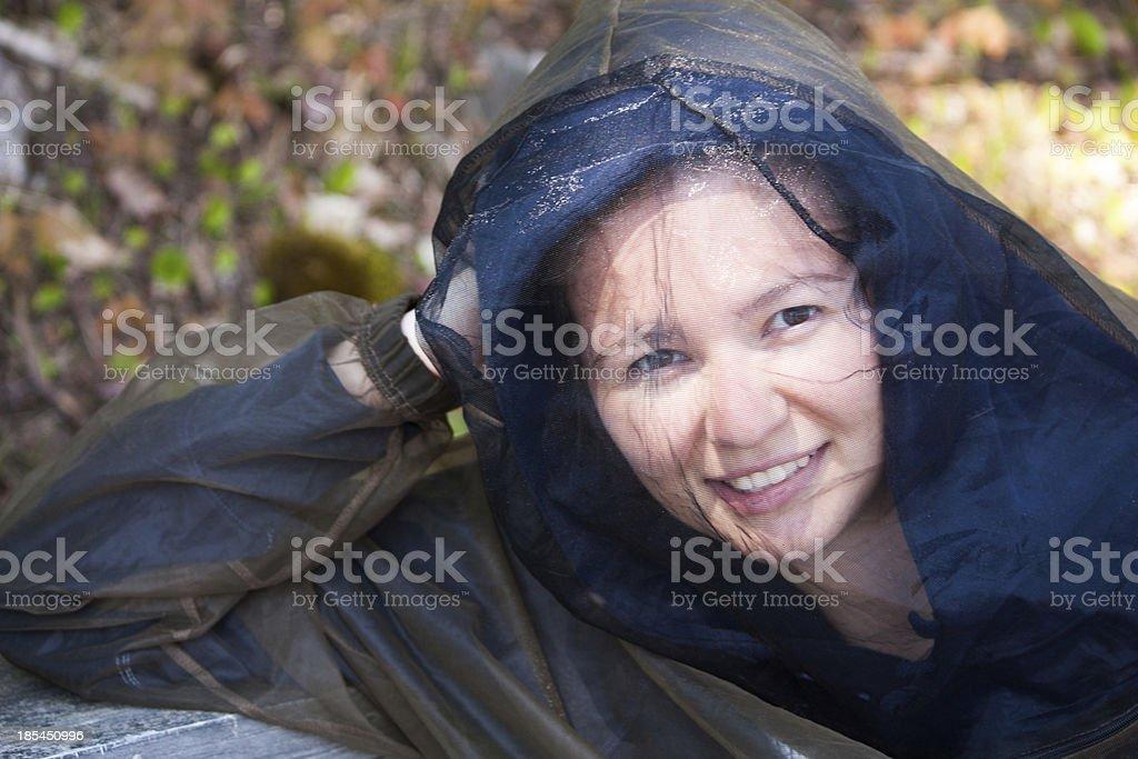 Young woman wears bug hood stock photo
