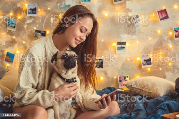 Young woman weekend at home decorated bedroom with dog using picture id1144444241?b=1&k=6&m=1144444241&s=612x612&h=qatnljof jtws3idqjkokxq7mksxmnpg61knq0qlhii=