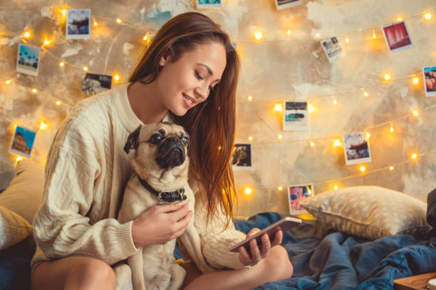 Young woman weekend at home decorated bedroom with dog using picture id1144444241?b=1&k=6&m=1144444241&s=612x612&w=0&h=rzouxqicnyjqqbgvg4ek2vc762tv1hwtzteqw3axppa=