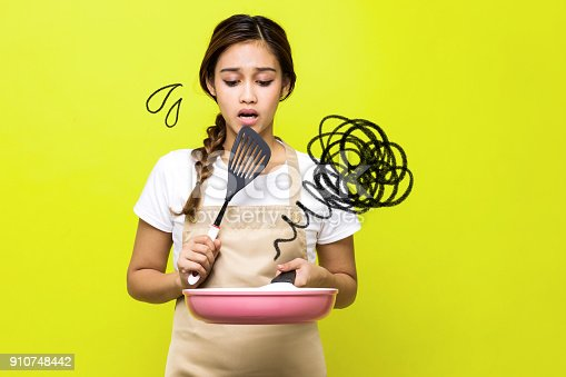 istock Young woman who failed cooking. 910748442