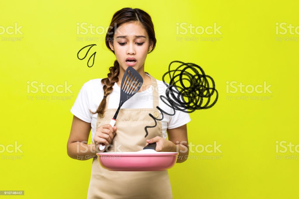 Young woman who failed cooking. stock photo