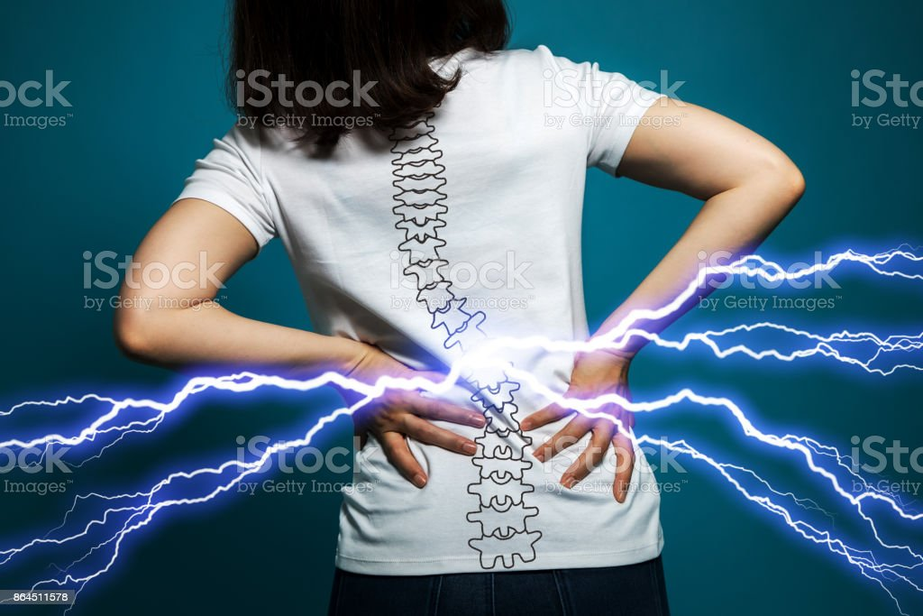 young woman who has backache. stock photo