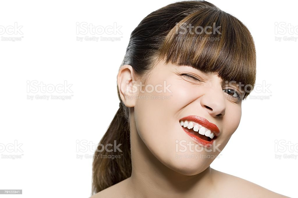Young woman winking 免版稅 stock photo