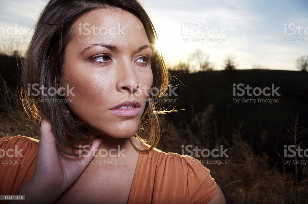young woman winter sunset portraits stock photo
