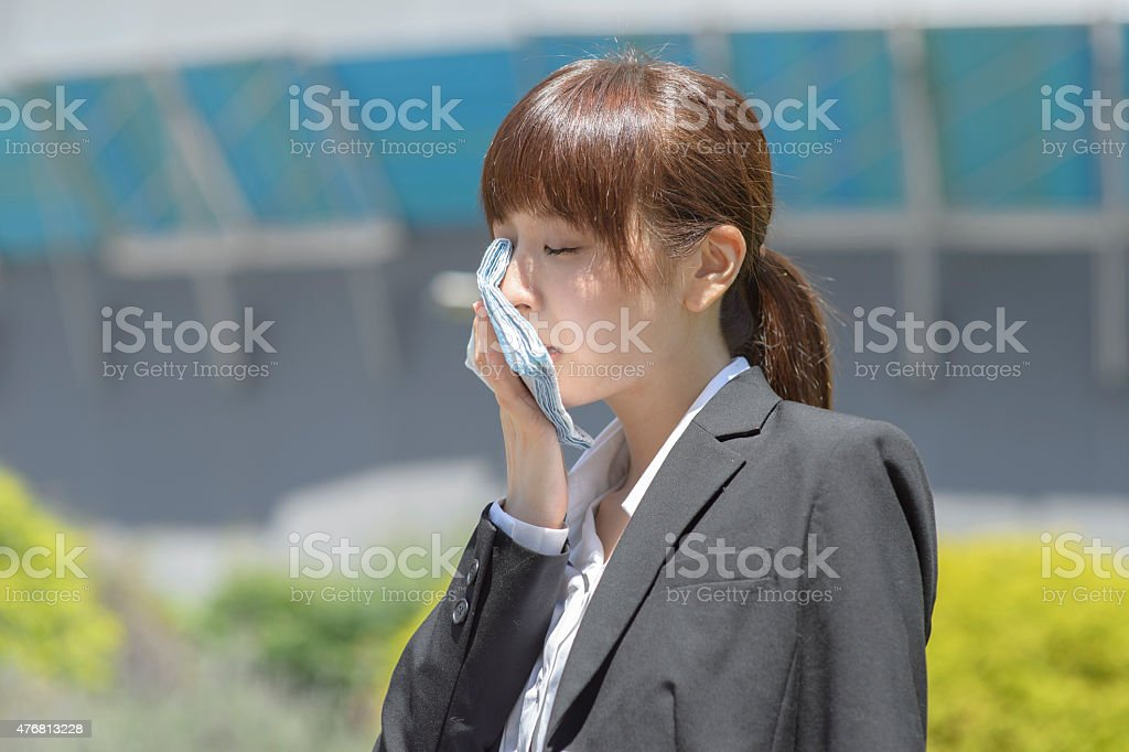Young woman wiping the sweat stock photo