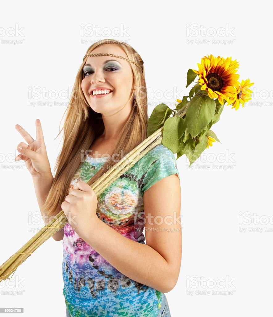 Young Woman With 1960's Outfit and Sunflowers royalty-free stock photo