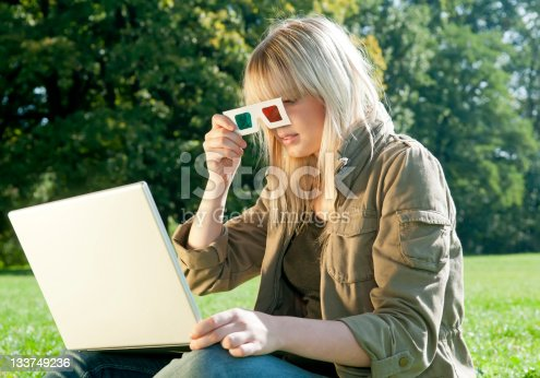 istock young woman with 3D-glasses and laptop 133749236