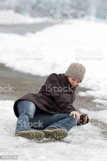 Photo of young woman with a accident on a icy street