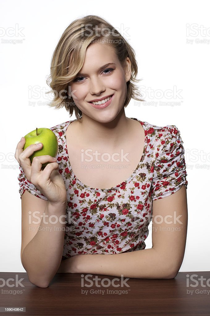 Young Woman with a apple royalty-free stock photo