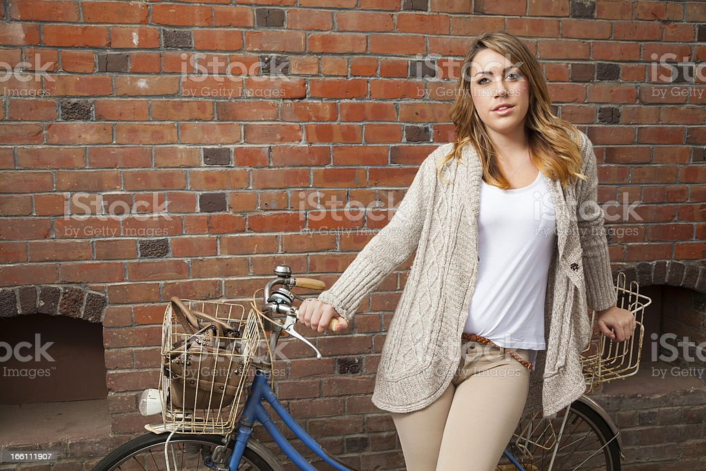 Young woman with a bicycle royalty-free stock photo