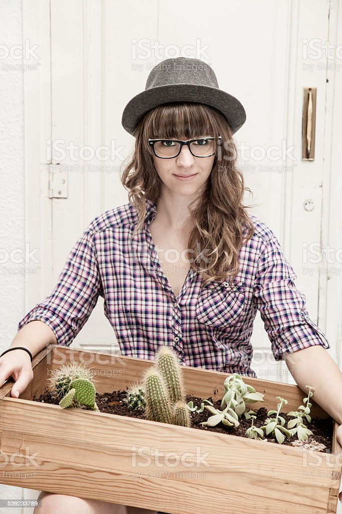 Young woman with a box garden royalty-free stock photo
