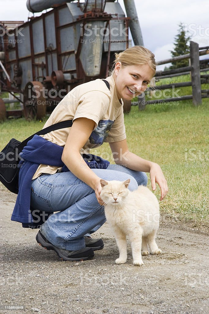 young woman with a cat royalty-free stock photo