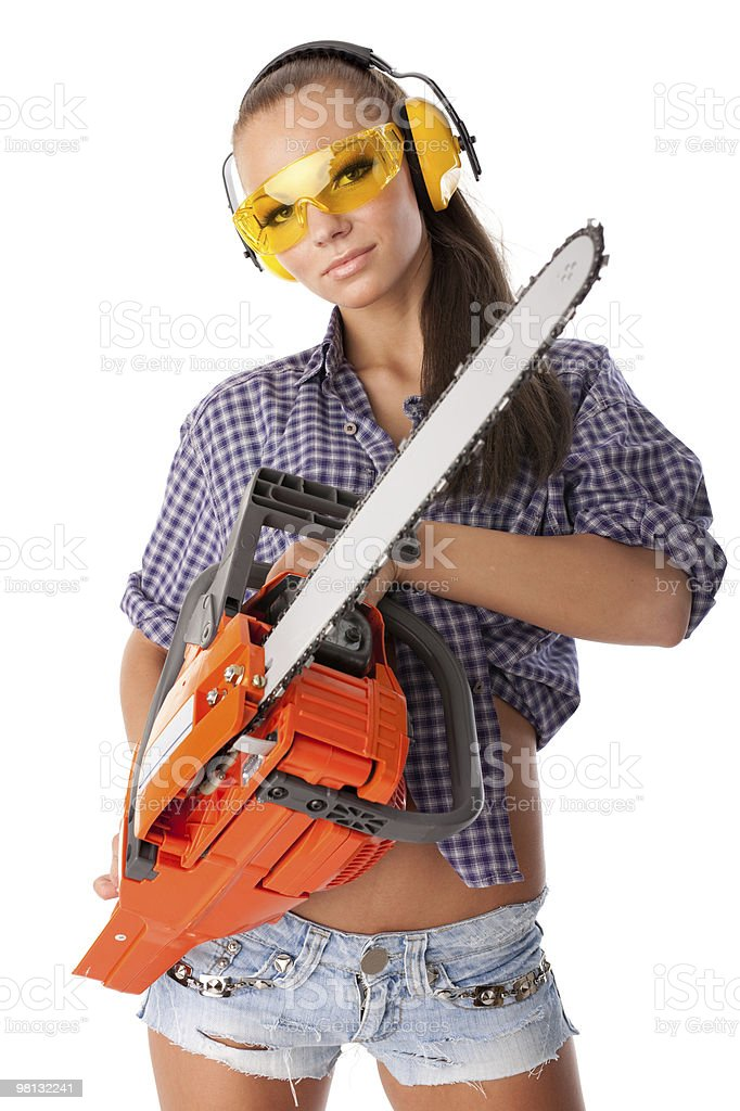 Young woman with a chainsaw royalty-free stock photo