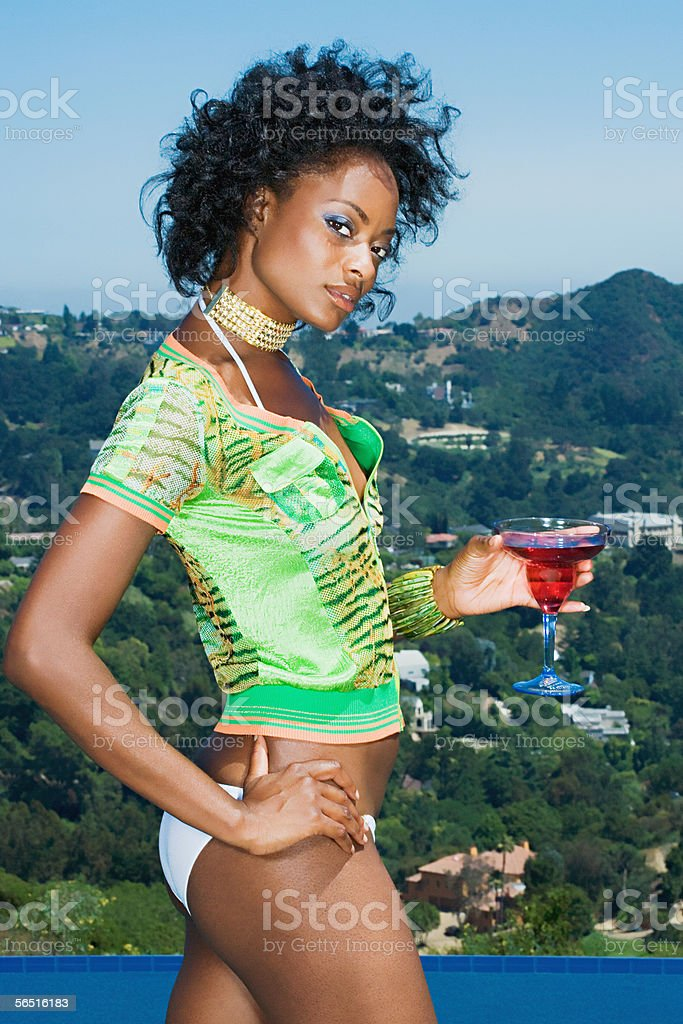 Young woman with a cocktail royalty-free stock photo