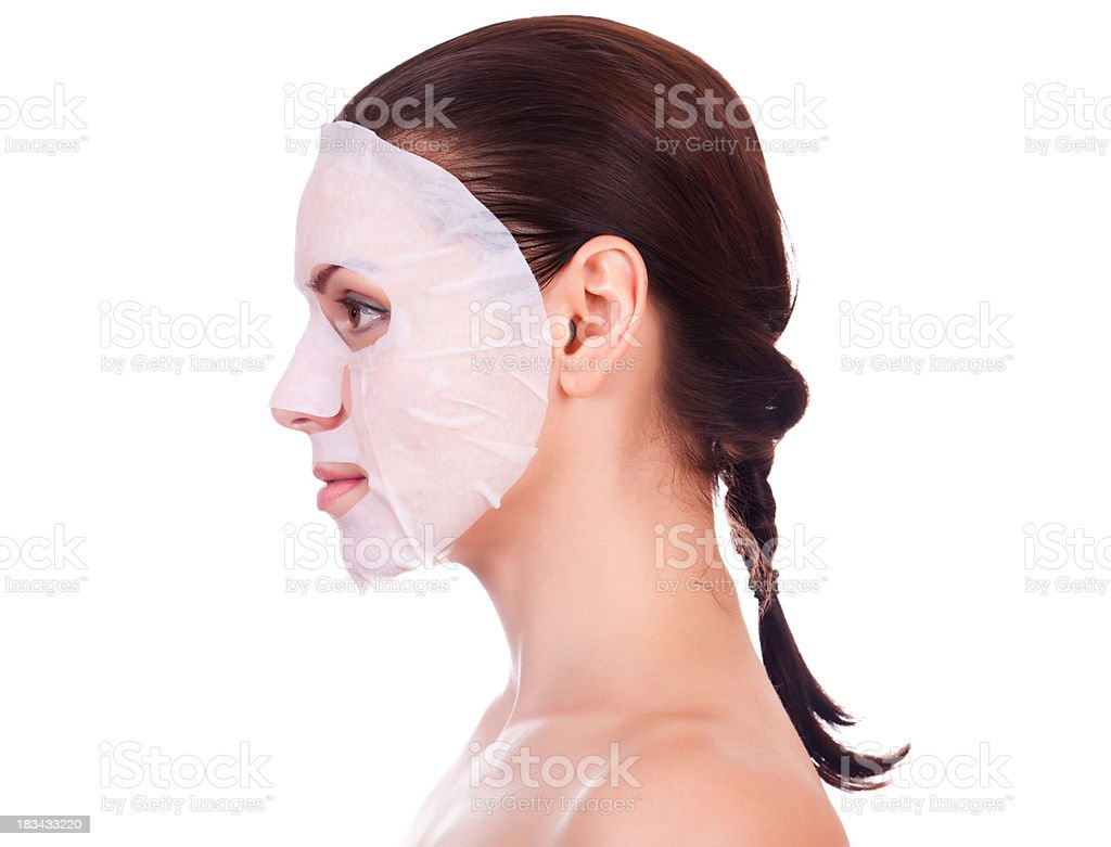young woman with a cosmetic mask royalty-free stock photo