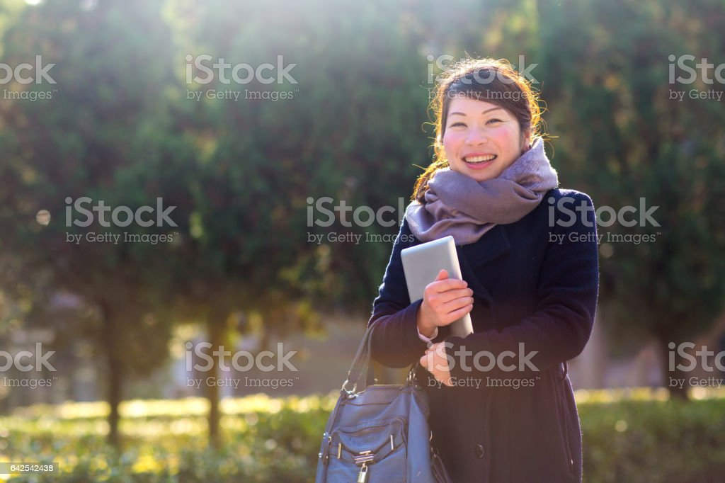 Young woman with a digital tablet in Kyoto, Japan stock photo