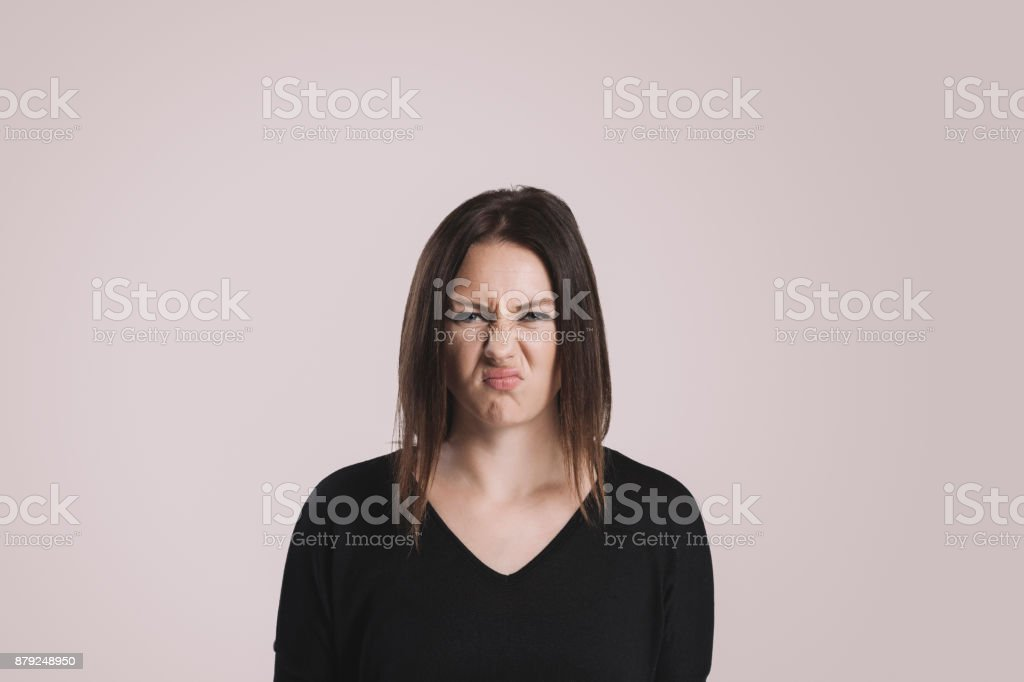 Young woman with a disgusted expression stock photo