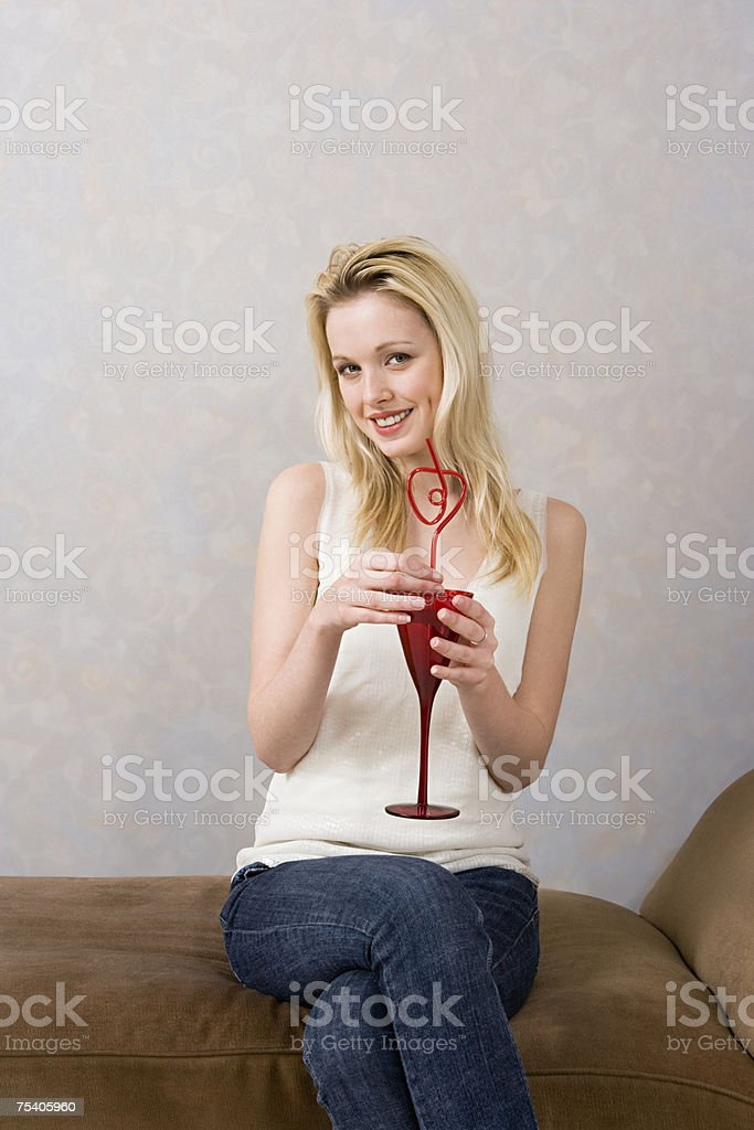 Young woman with a drink royalty-free stock photo