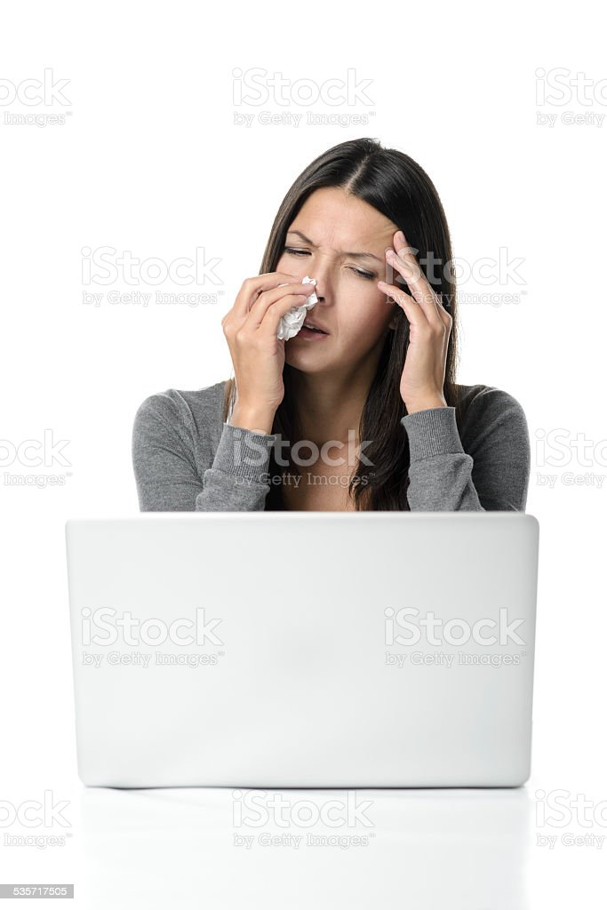 Young woman with a fever and chills stock photo