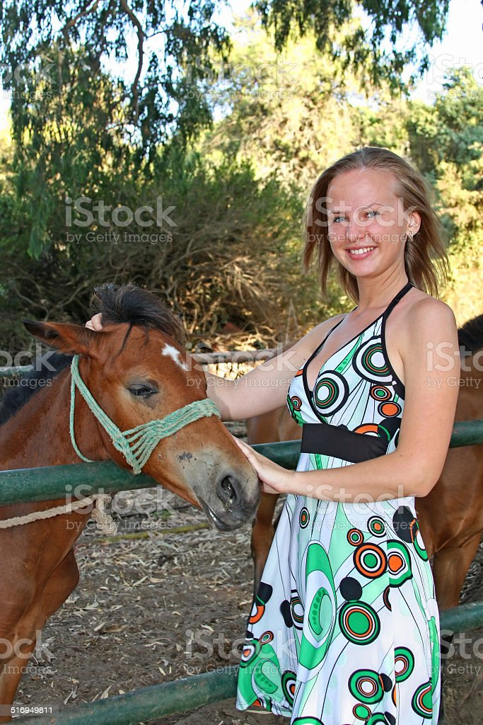 Young woman with a foal stock photo