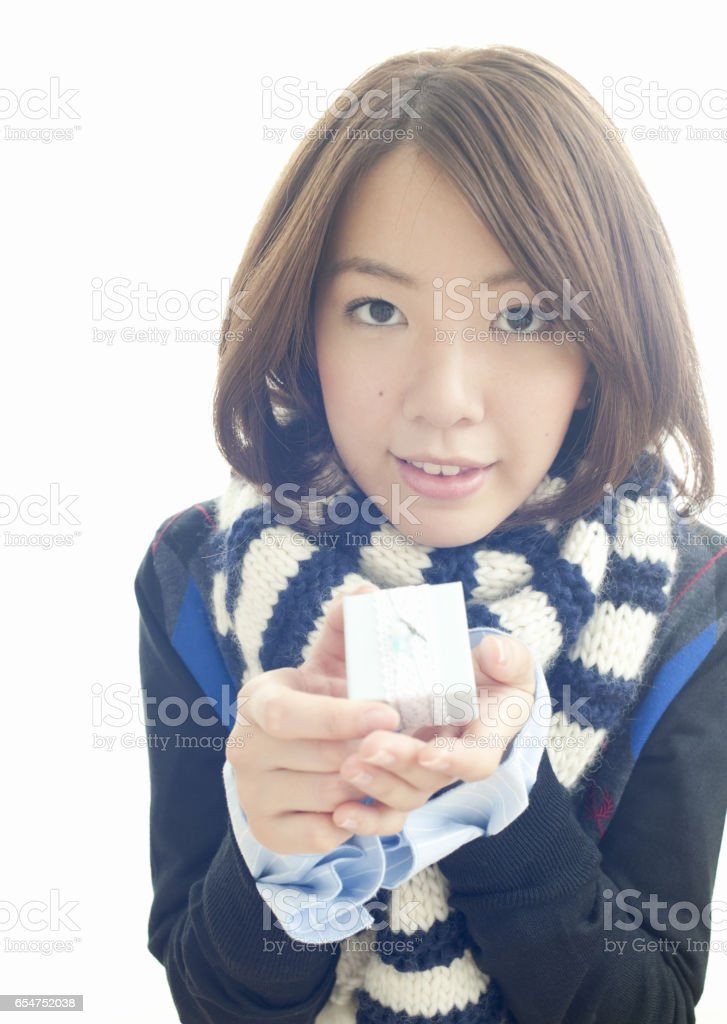 Young woman with a gift stock photo